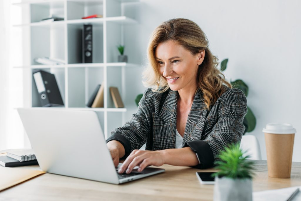 Procurement professional viewing webinar on laptop.