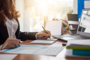 woman working on financial reports